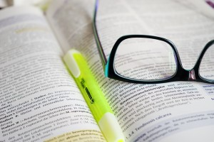 glasses on an open university course book