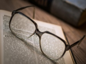 Glasses on an Open University book
