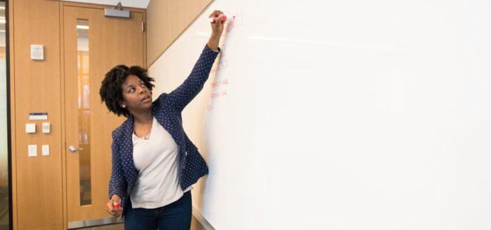 Teacher with whiteboard